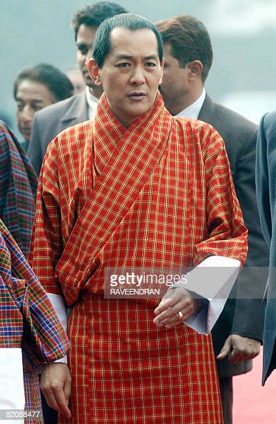 Bhutan's King Jigme Singye Wangchuck arrives to a welcome ceremony at the Presidential Palace in New Delhi 25 January 2005 Wangchuck has started a...