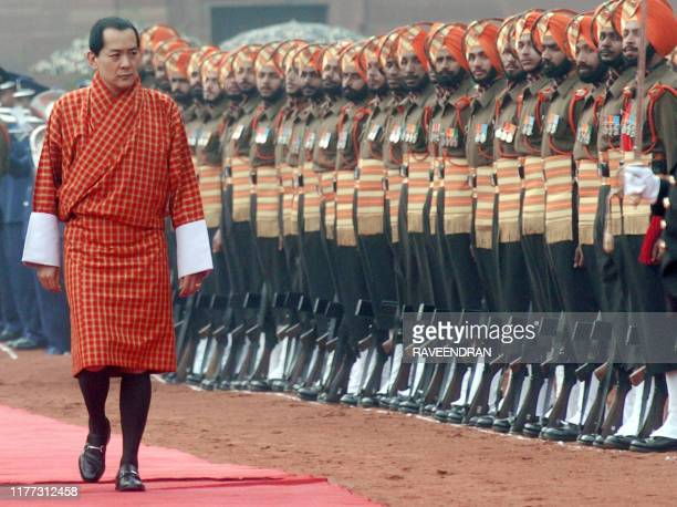 Bhutan's King Jigme Singye Wangchuck inspects a Guard of Honour during a welcome ceremony at the Presidential Palace in New Delhi 25 January 2005...