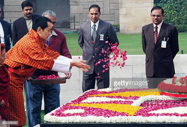 Bhutan's King Jigme Singye Wangchuck offers rose petals at the memorial of the father of the nation Mahatma Gandhi in New Delhi 25 January 2005...