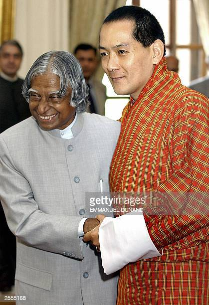 Bhutan's King Jigme Singye Wangchuk shakes hands with Indian President A.P.J. Abdul Kalam, 15 September 2003, during a welcoming ceremony at...