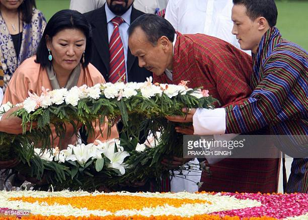 Bhutan's Prime Minister Lyonchen Jigmi Y Thinley lays a wreath with his wife Aum Rinsy Dem at Rajghat memorial for Indian Father of the Nation...