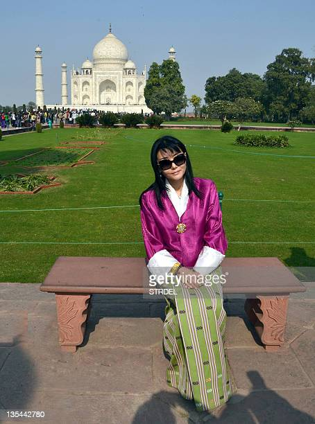Bhutan's Queen Jetsun Pema poses for a photo at the Taj Mahal in Agra on December 10 2011 Queen Pema is in India touring the country AFP PHOTO/ STR