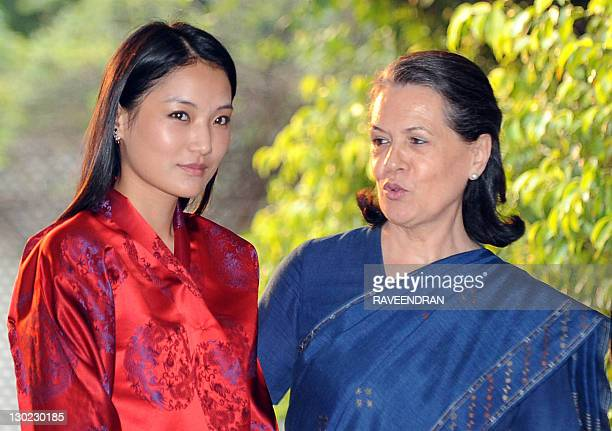 Bhutan's Queen Jetsun Pema poses for a photo with Chairperson of Congressled UPA government and Congress Party President Sonia Gandhi during a...