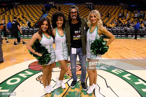 Bhuvan Bam poses for a photo with Boston Celtics cheerleaders after the game against the Brooklyn Nets on April 11 2018 at the TD Garden in Boston...