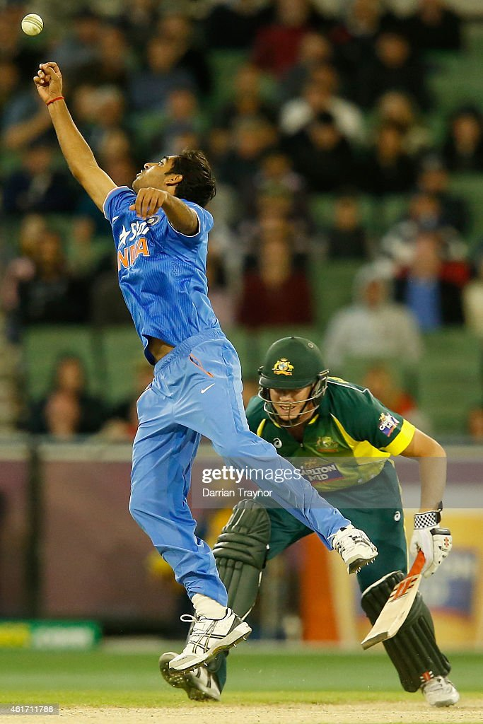 Bhuvneshwar Kumar of India attempts to stop the ball during the One Day International match between Australia and India at Melbourne Cricket Ground on January 18, 2015 in Melbourne, Australia.
