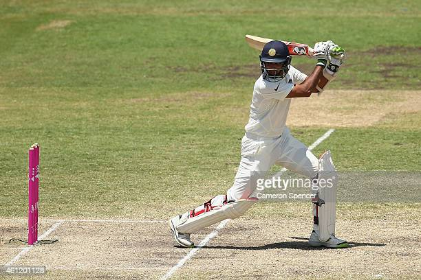 Bhuvneshwar Kumar of India bats during day four of the Fourth Test match between Australia and India at Sydney Cricket Ground on January 9 2015 in...