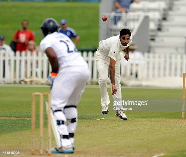 Bhuvneshwar Kumar of India bowls during day one of the tour match between Derbyshire and India at The 3aaa County Ground on July 1 2014 in Derby...