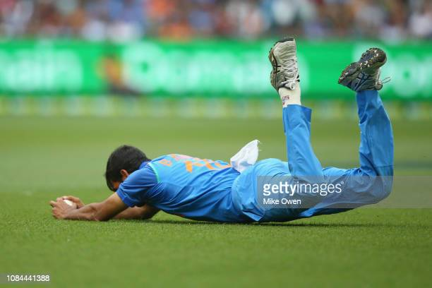 Bhuvneshwar Kumar of India catches out Glenn Maxwell of Australia during game three of the One Day International series between Australia and India...