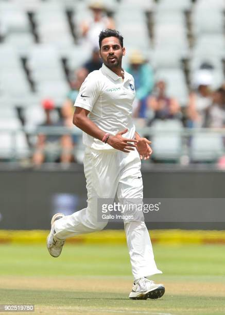 Bhuvneshwar Kumar of India celebrate after taking the wicket of Keshav Maharaj of South Africa during day 4 of the 1st Sunfoil Test match between...