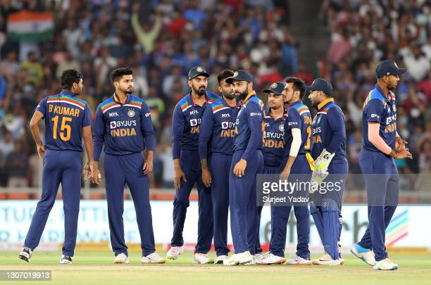 Bhuvneshwar Kumar of India celebrates after taking the wicket of Jos Buttler of England with team mates during the 2nd T20 International match...