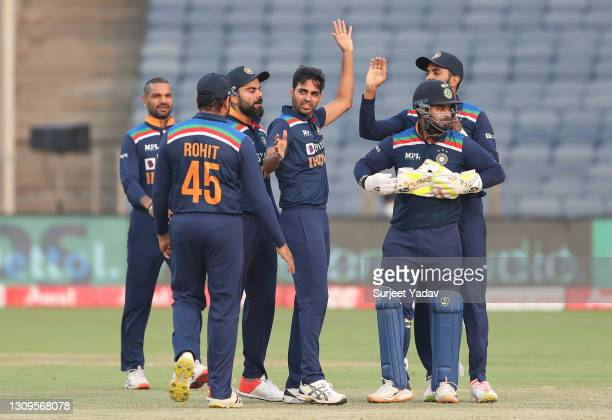 Bhuvneshwar Kumar of India celebrates after taking the wicket of Jonny Bairstow of England during the 3rd One Day International match between India...