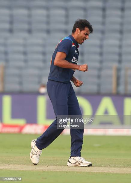 Bhuvneshwar Kumar of India celebrates after taking the wicket of Jason Roy of England during the 3rd One Day International match between India and...