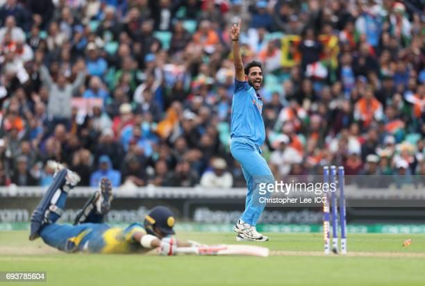 Bhuvneshwar Kumar of India celebrates running out Kusal Mendis of Sri Lanka during the ICC Champions Trophy Group B match between India and Sri Lanka...