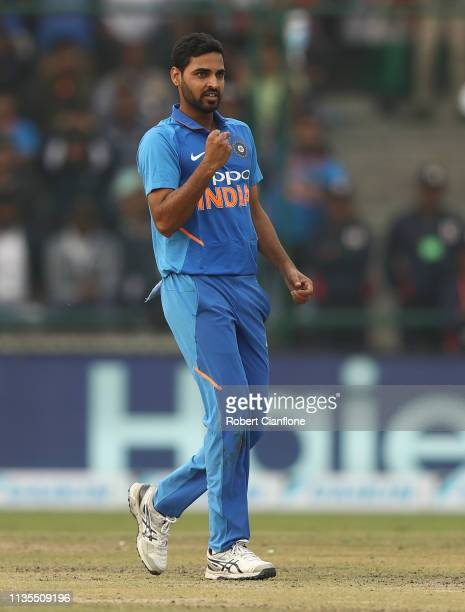 Bhuvneshwar Kumar of India celebrates taking the wicket of Marcus Stoinis of Australia during game five of the One Day International series between...