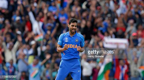 Bhuvneshwar Kumar of India celebrates taking the wicket of Marcus Stoinis of Australia during the Group Stage match of the ICC Cricket World Cup 2019...