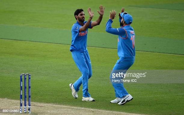 Bhuvneshwar Kumar of India celebrates the wicket of Mahmudullah of Bangladesh during the ICC Champions Trophy Warmup match between India and...