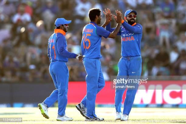Bhuvneshwar Kumar of India celebrates the wicket of Martin Guptill of the Black Caps with Virat Kohli during game two of the One Day International...