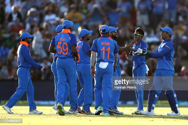 Bhuvneshwar Kumar of India celebrates the wicket of Martin Guptill of the Black Caps with Virat Kohli during game two of the One Day International...
