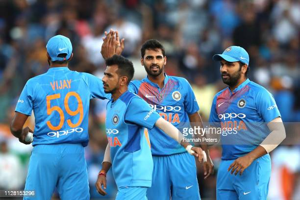 Bhuvneshwar Kumar of India celebrates the wicket of Tim Seifert of the Black Caps during game two of the International T20 Series between the New...