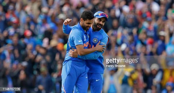 Bhuvneshwar Kumar of India celebrates with Ravindra Jadeja taking the wicket of Marcus Stoinis of Australia during the Group Stage match of the ICC...