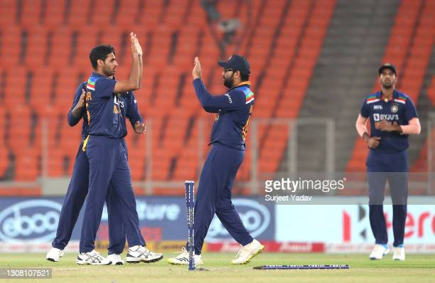 Bhuvneshwar Kumar of India celebrates with team mates after bowling Jason Roy of England during the 5th T20 International between India and England...