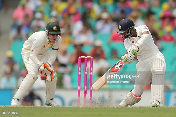 Bhuvneshwar Kumar of India is caught at second slip off the bowling of Nathan Lyon of Australia during day four of the Fourth Test match between...