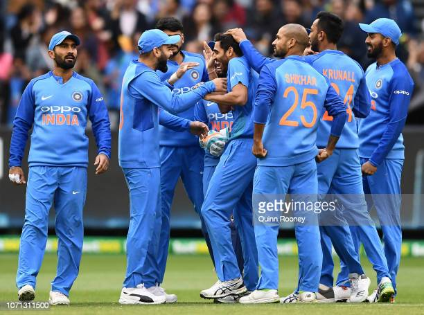 Bhuvneshwar Kumar of India is congratulated by team mates after getting the wicket of Aaron Finch of Australia during the International Twenty20...