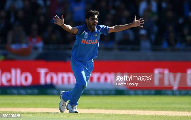 Bhuvneshwar Kumar of India successfully appeals for the wicket of Ahmed Shehzad of Pakistan during the ICC Champions Trophy match between India and...