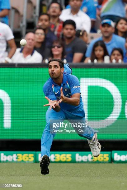 Bhuvneshwar Kumar of India takes a catch to dismiss Glenn Maxwell of Australia during game three of the One Day International series between...