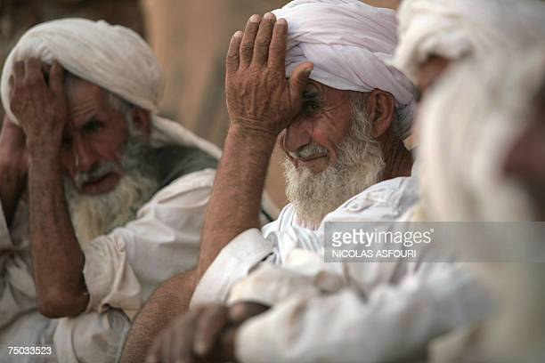 Biabanak, AFGHANISTAN: Afghan village elders listen to unseen US soldier Captain Don Canterna from Bravo Company 1-508 Parachute Infantry Regiment...