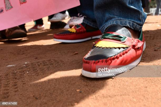 A Biafra supporter wears shoes with the colours of the Biafra flag on May 30 in Abidjan during a ceremony marking the 50 years to the day since an...