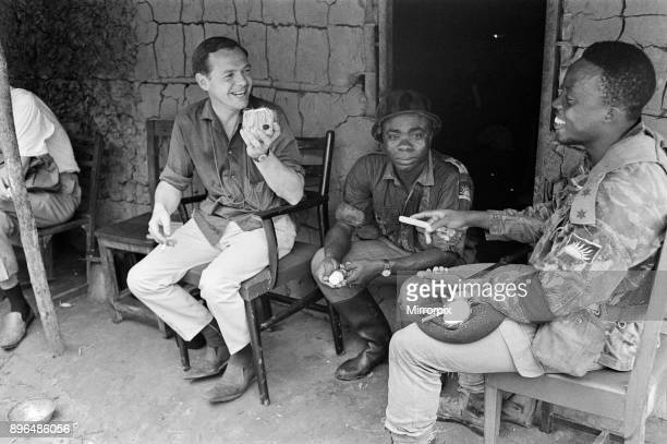A Biafran officer seen here with Daily Herald staff photographer Ron Burton during the Biafra conflict 11th June 1968