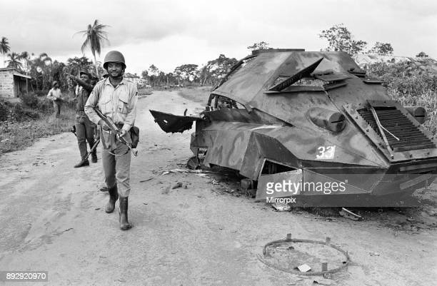 A Biafran soldier seen here beside a destroyed Nigerian army armoured personnel carrier during the conflict 11th June 1968
