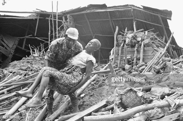 A Biafran soldier seen here helping an old lady from the wreckage of her home following a artillery bombard by the Nigerian army 11th June 1968