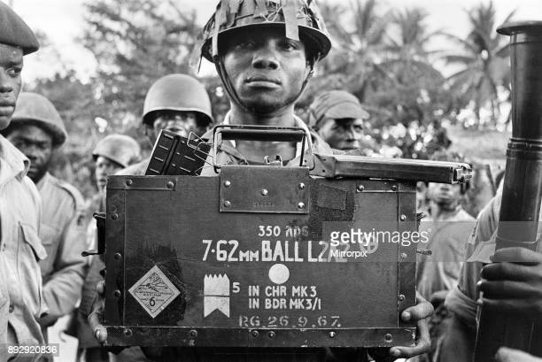 A Biafran soldier seen here holding a box of explosives during the Biafran conflict 11th June 1968