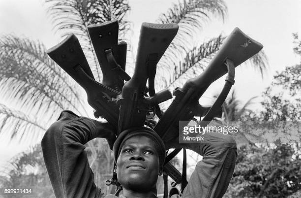 A Biafran soldier seen here holding a selection of guns during the Biafran conflict 11th June 1968