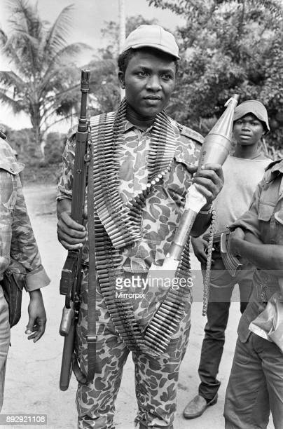 A Biafran soldier seen here holding an AK47 assault rifle in one hand and a rocket propelled grenade in the other during the Biafran conflict 11th...