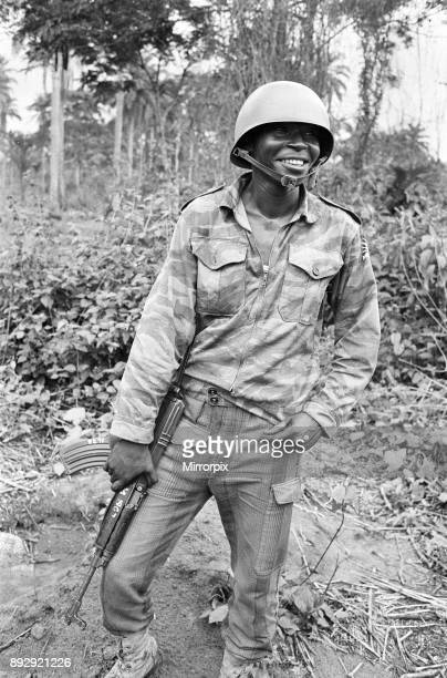 A Biafran soldier seen here in relaxed mood armed with an AK47 semi automatic rifle during the Biafra Conflict 11th June 1968