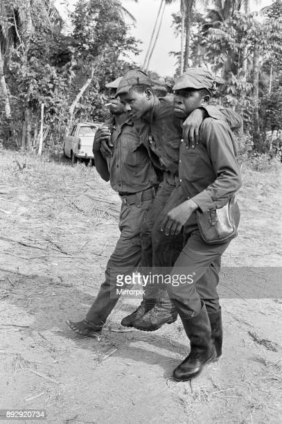 Biafran soldiers seen here carrying an injured comrade during the Biafra conflict 11th June 1968