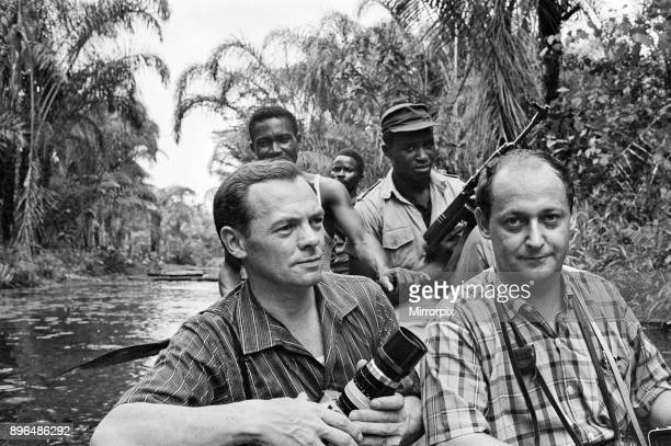 Biafran soldiers seen here crossing the river ina canoe with Daily Herald staff photographer Ron Burton during the Biafra conflict 11th June 1968