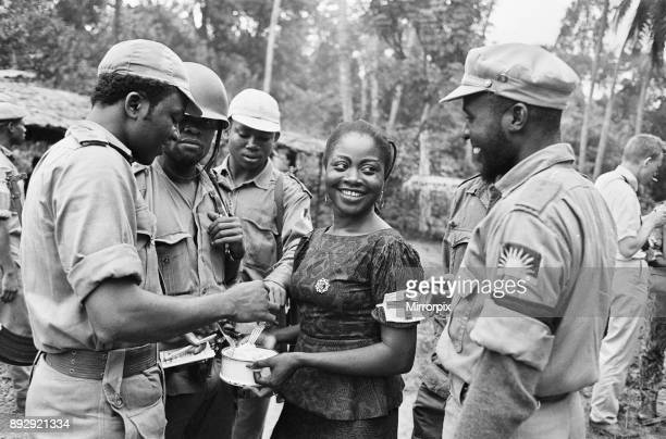 Biafran soldiers seen here enjoying some food held by an aid worker during the Biafran conflict 11th June 1968