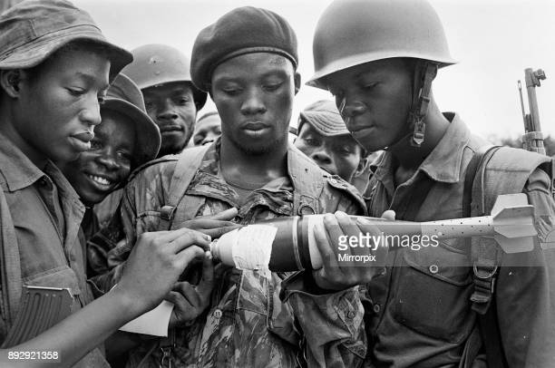 Biafran soldiers seen here inspecting a bomb during the Biafran conflict 11th June 1968