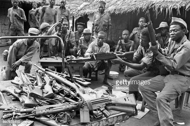 Biafran soldiers seen here testing out a large stockpile of weapons during the conflict 11th June 1968