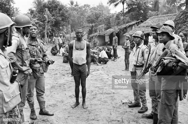 Biafran soldiers seen here with a captured Nigerian soldier during the Biafran conflict 11th June 1968