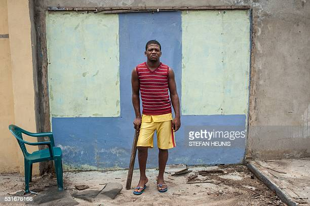 Biafran supporter Chinedu Iwu who got shot in the leg during a proBiafra protest in 2015 poses for a photo in Port Harcourt on May 3 2016 Over the...