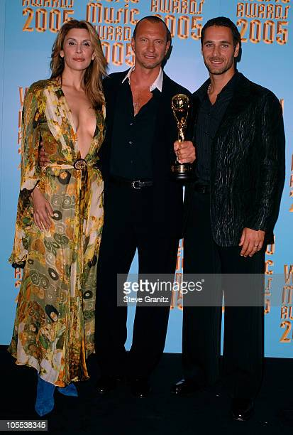 Biagio Antonacci winner of BestSelling International Act and presenters Jo Champa and Raoul Bova