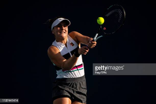 Bianca Adreescu of Canada hits a backhand against IrinaCamelia Begu of Romania in the second round of the women's singles at the Miami Open on March...