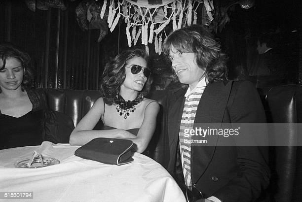 Bianca and Mick Jagger attend Andy Warhol's preopening party at the Copacabana Club Bianca flew in from London where she is shooting a movie to make...