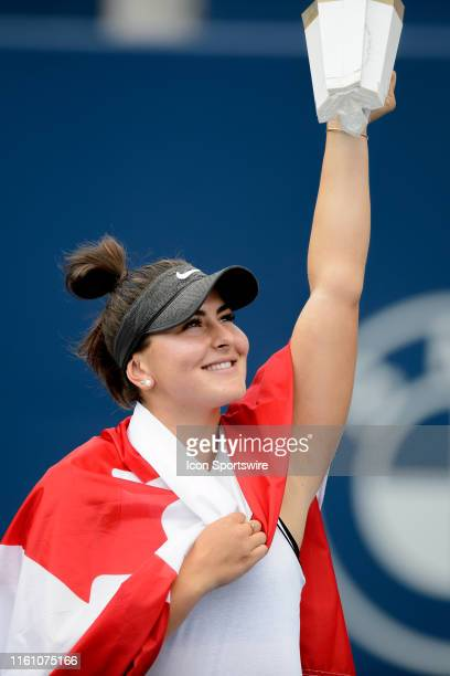 Bianca Andreescu lifts the championship trophy after winning the Rogers Cup tennis tournament final on August 11 at Aviva Centre in Toronto ON Canada