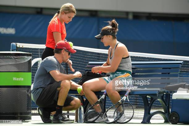 Bianca Andreescu of Canada and her coach Sylvain Bruneau practice ahead of her during her Women's Singles final match against Serena Williams of the...
